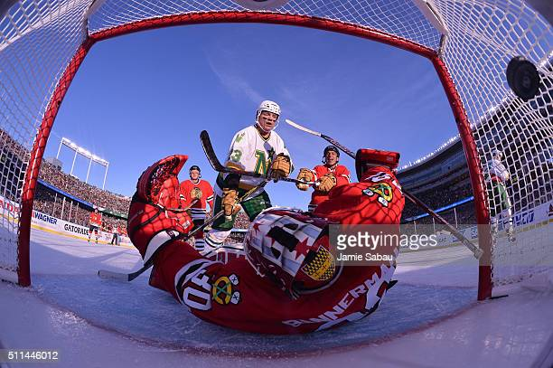 Brian Bellows of the Minnesota North Stars Alumni scores against goaltender Murray Bannerman of the Chicago Blackhawks Alumni during the 2016 Coors...