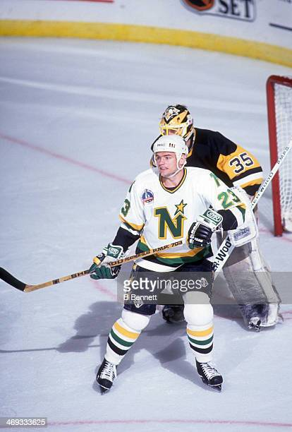 Brian Bellows of the Minnesota North Stars screens goalie Tom Barrasso of the Pittsburgh Penguins during Game 3 of the 1991 Stanley Cup Finals on May...
