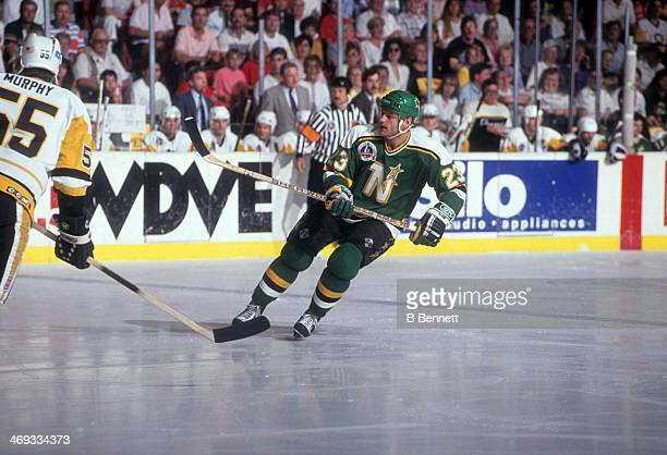 Brian Bellows of the Minnesota North Stars skates on the ice against the Pittsburgh Penguins during Game 1 of the 1991 Stanley Cup Finals on May 15,...