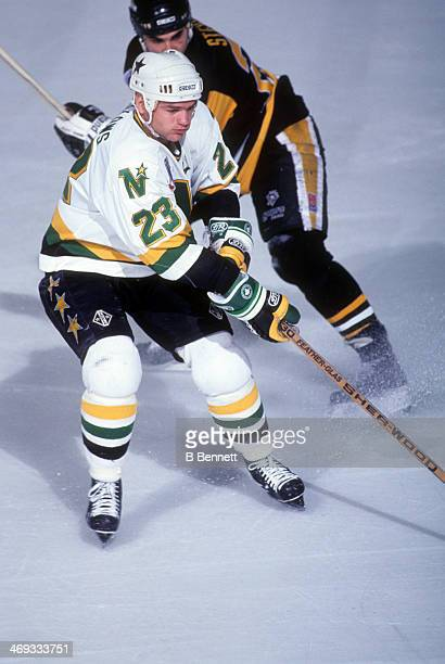 Brian Bellows of the Minnesota North Stars skates on the ice as Kevin Stevens of the Pittsburgh Penguins follows behind during Game 3 of the 1991...