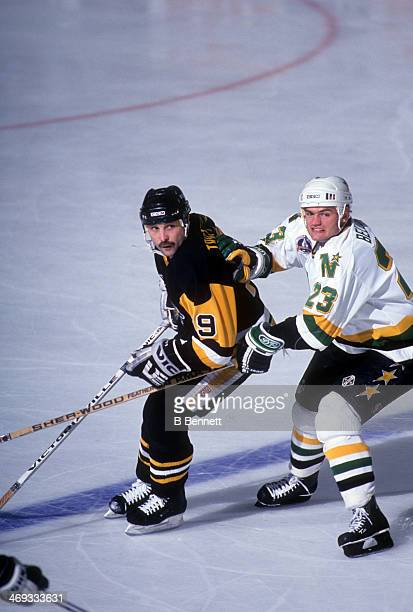 Brian Bellows of the Minnesota North Stars tries to hook Bryan Trottier of the Pittsburgh Penguins during Game 3 of the 1991 Stanley Cup Finals on...