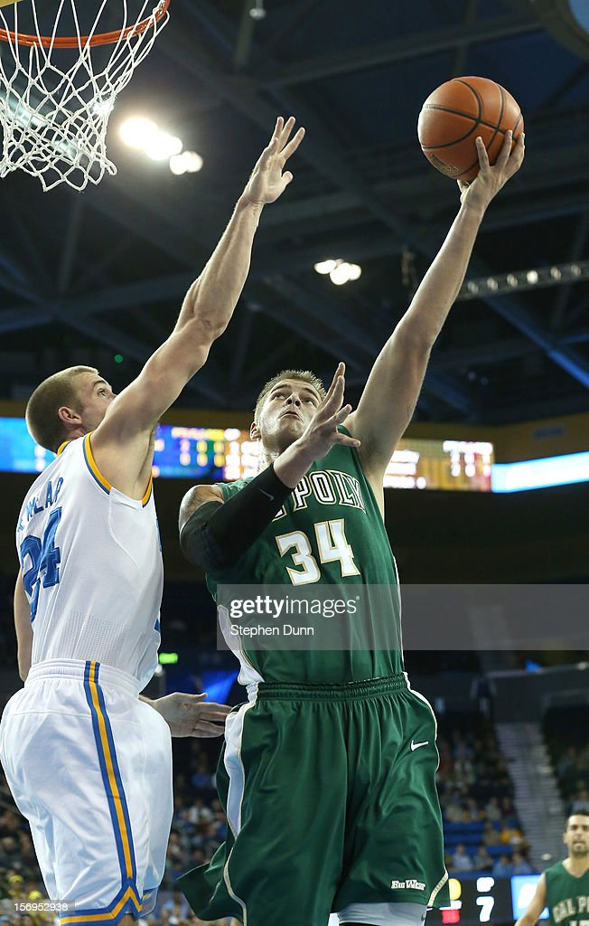 Brian Bennett #34 of the Cal Poly Mustangs shoots over Travis Wear #24 of the UCLA Bruins at Pauley Pavilion on November 25, 2012 in Los Angeles, California.