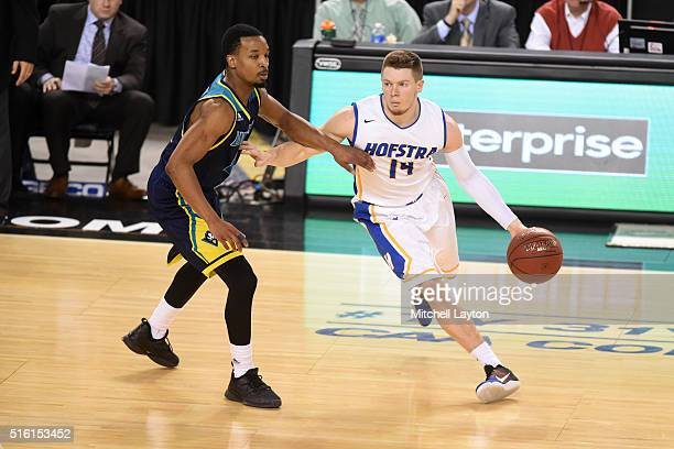 Brian Bernardi of the Hofstra Pride dribble the ball around Denzel Ingram of the North CarolinaWilmington Seahawks during the Colonial Athletic...