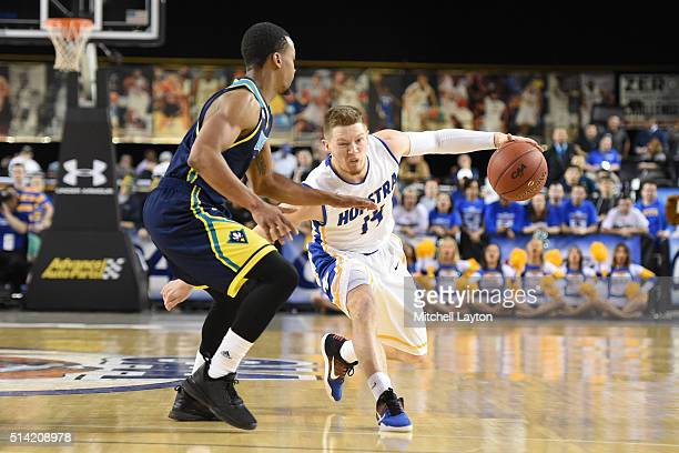 Brian Bernardi of the Hofstra Pride tries to dribble around Denzel Ingram of the North CarolinaWilmington Seahawks during the Colonial Athletic...