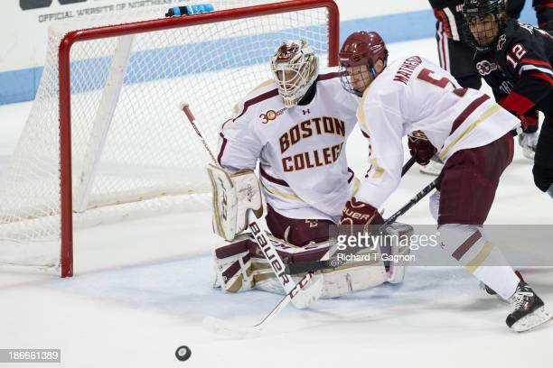 Brian Billett of the Boston College Eagles makes a save next to Michael Matheson of the Boston College Eagles against the Northeastern University...