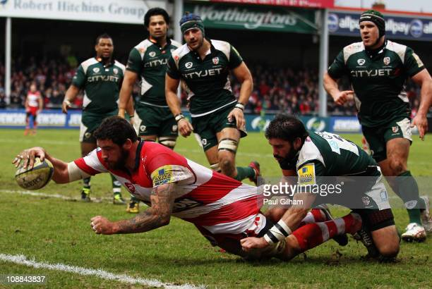 Brian Blaney of London Irish tries in vain to stop Jim Hamilton of Gloucester scoring a try during the LV Anglo Welsh Cup match between Gloucester...