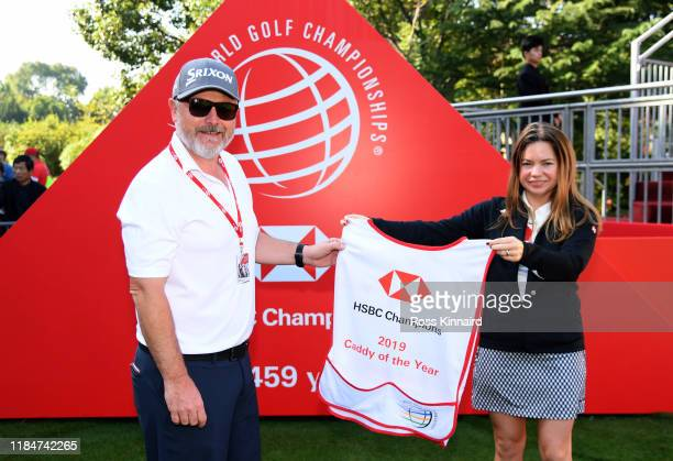 Brian Bo Martin is presented with the Caddy of the Year bib on the first tee during Day Two of the WGC HSBC Champions at Sheshan International Golf...
