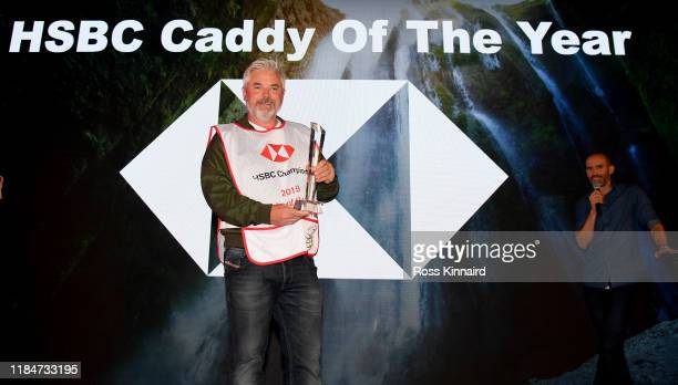 Brian 'Bo' Martin the caddie of Shane Lowry is presented with the 'HSBC Caddy of the Year' award after the first round of the WGC HSBC Champions at...