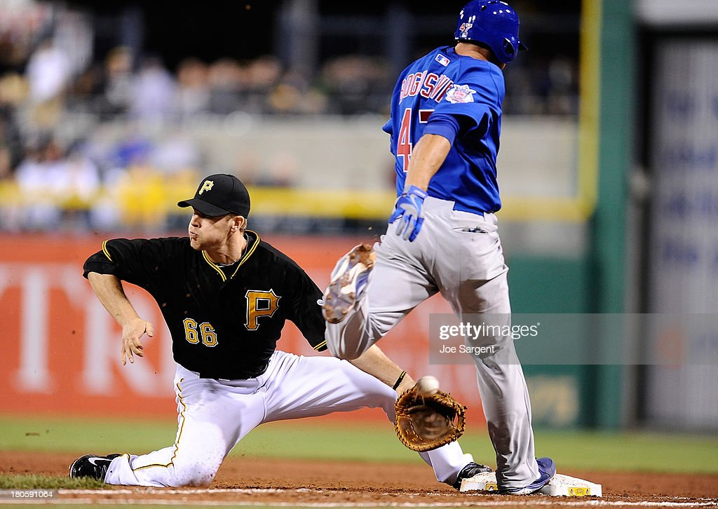 Brian Bogusevic #47 of the Chicago Cubs is safe at first base in front of Justin Morneau #66 of the Pittsburgh Pirates on September 14, 2013 at PNC Park in Pittsburgh, Pennsylvania.