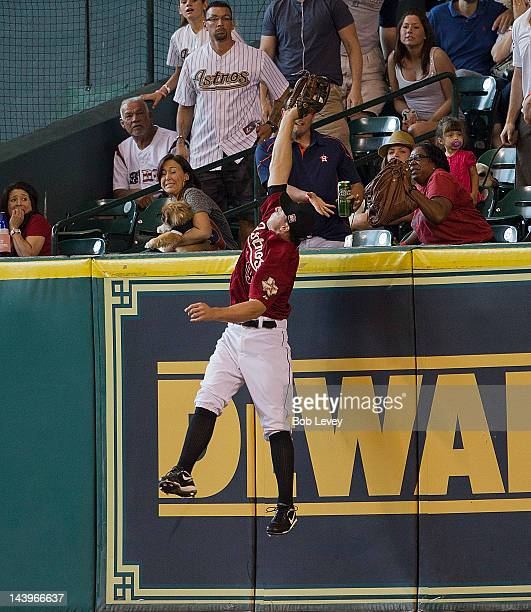 Brian Bogusevic of the Houston Astros makes a leaping catch at the wall on a fly ball hit by David Freese of the St Louis Cardinals in the seventh...