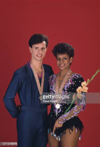 Brian Boitano and Debi Thomas of the United States celebrate winning gold in the Men's and Ladies Figure Skating Singles competitions during the ISU...