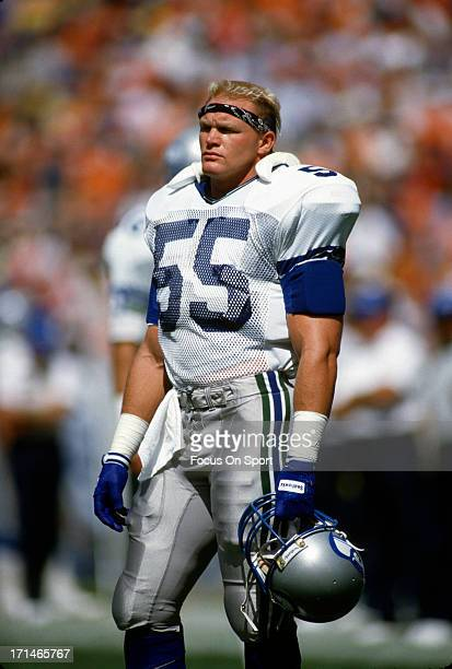Brian Bosworth of the Seattle Seahawks looks on while there's a break in the action against the Denver Broncos during an NFL football game September...