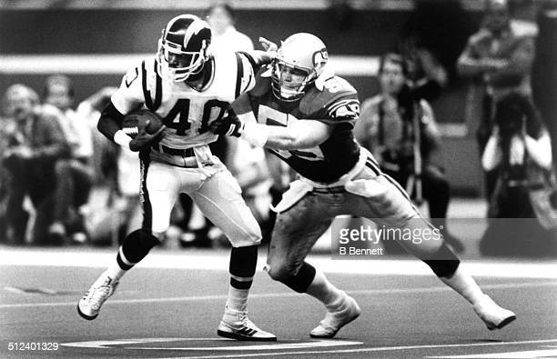 Brian Bosworth of the Seattle Seahawks tries to tackle Gary Anderson of the San Diego Chargers on October 30 1988 at the Kingdome in Seattle...