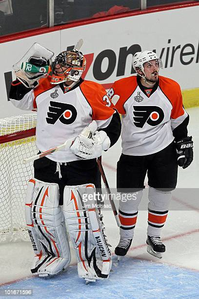Brian Boucher and Danny Briere of the Philadelphia Flyers take a breather in Game Five of the 2010 NHL Stanley Cup Final against the Chicago...