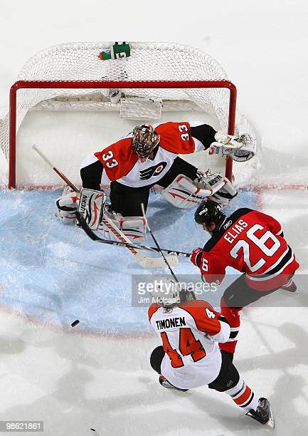 Brian Boucher and Kimmo Timonen of the Philadelphia Flyers stop a shot on goal by Patrik Elias of the New Jersey Devils in Game 5 of the Eastern...