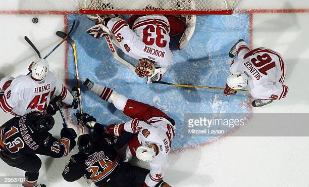 Brian Boucher, Mike Sillinger, Radoslav Suchy and Brad Ference of the Phoenix Coyotes defend against Mike Grier and Bates Battaglia of the Washington...