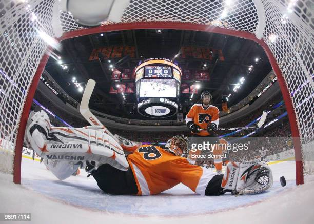 Brian Boucher of the Philadelphia Flyers can't stop a first period goal by Marc Recchi of the Boston Bruins in Game Four of the Eastern Conference...