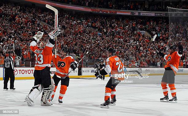 Brian Boucher of the Philadelphia Flyers celebrates his game winning shootout save against the New York Rangers with teammates Daniel Briere, Matt...