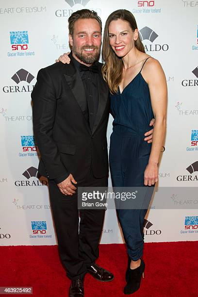Brian Bowen Smith and Hilary Swank attend Geraldo Jewelry presents 'Icons Of The Awards' Benefiting The Art Of Elysium at Mr C Beverly Hills on...