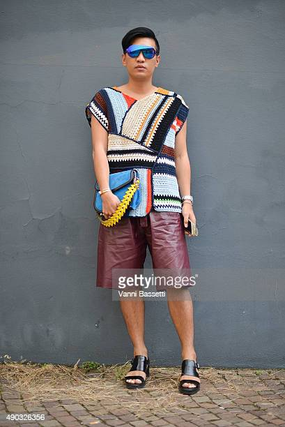 Brian Boy poses with a Loewe bag before the MSGM show during the Milan Fashion Week Spring/Summer 16 on September 27 2015 in Milan Italy
