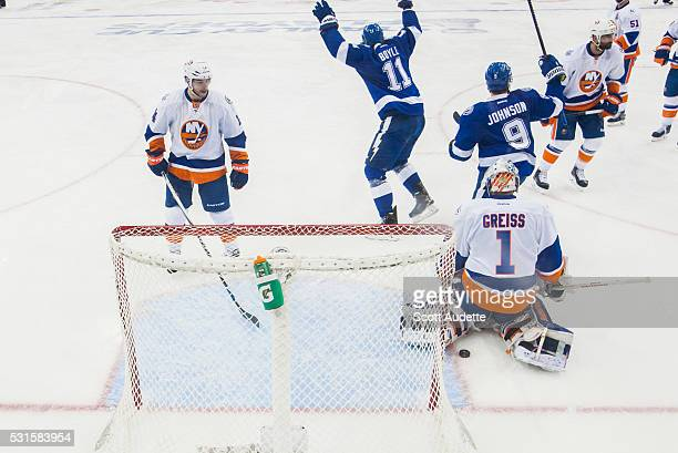 Brian Boyle and Tyler Johnson of the Tampa Bay Lightning celebrate a goal against goalie Thomas Greiss and Thomas Hickey of the New York Islanders...