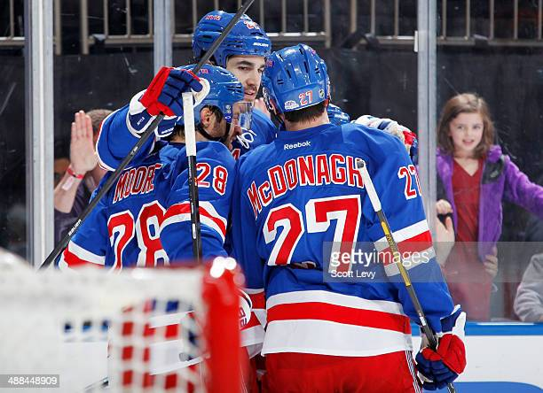 Brian Boyle Dominic Moore and Ryan McDonagh of the New York Rangers celebrate after a third period goal against the Philadelphia Flyers in Game Five...
