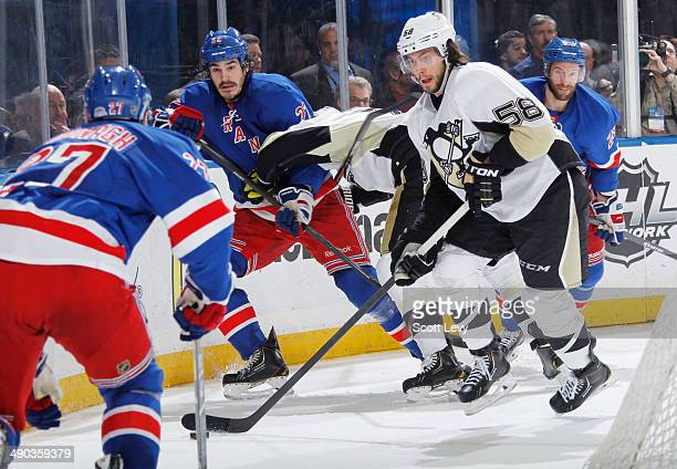 Brian Boyle Dominic Moore and Ryan McDonagh of the New York Rangers skate against Kris Letang of the Pittsburgh Penguins in Game Four of the Second...