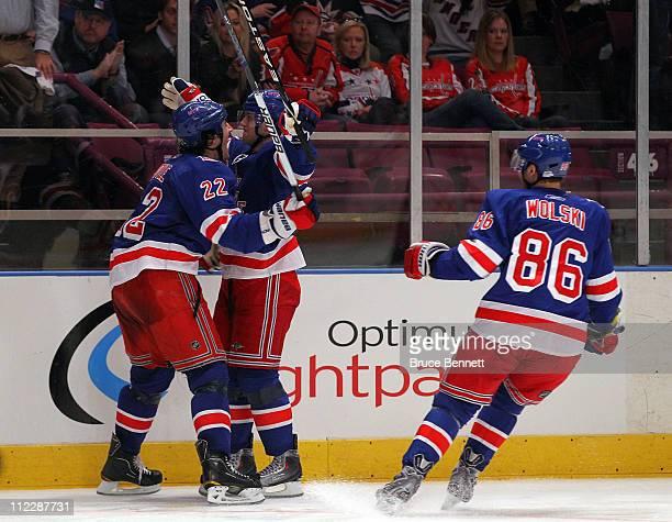 Brian Boyle, Erik Christensen and Wojtek Wolski of the New York Rangers celebrate after Christensen scored a second period goal against the...