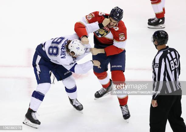 Brian Boyle of the Florida Panthers fights with Mikhail Sergadchev of the Tampa Bay Lightning during the third period in an exhibition game prior to...