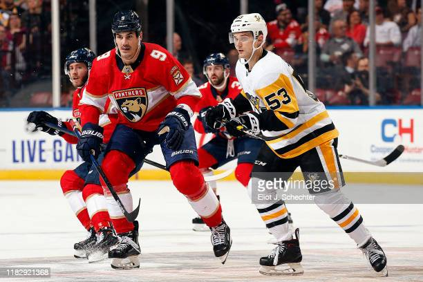 Brian Boyle of the Florida Panthers skates for position against Teddy Blueger of the Pittsburgh Penguins at the BBT Center on October 22 2019 in...