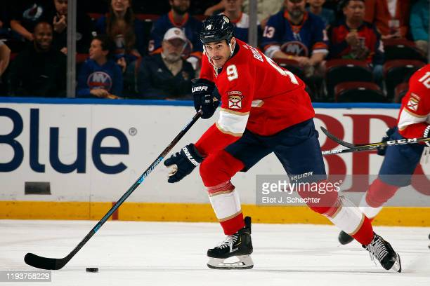 Brian Boyle of the Florida Panthers skates with the puck against the New York Islanders at the BBT Center on December 12 2019 in Sunrise Florida