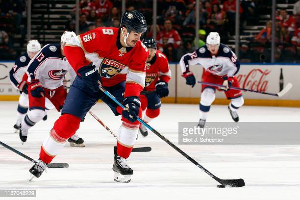 Brian Boyle of the Florida Panthers skates with the puck during first period action against the Columbus Blue Jackets at the BBT Center on December 7...