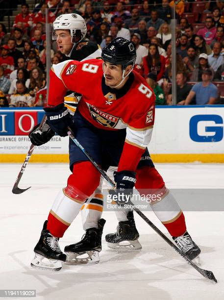 Brian Boyle of the Florida Panthers tangles with Charlie McAvoy of the Boston Bruins at the BBT Center on December 14 2019 in Sunrise Florida