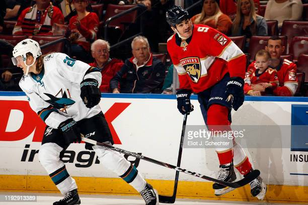 Brian Boyle of the Florida Panthers tangles with Markus Sorensen of the San Jose Sharks at the BBT Center on December 8 2019 in Sunrise Florida