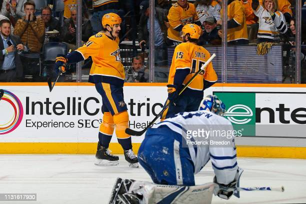 Brian Boyle of the Nashville Predators is congratulated by teammate Craig Smith after a goal against goalie Frederik Andersen of the Toronto Maple...