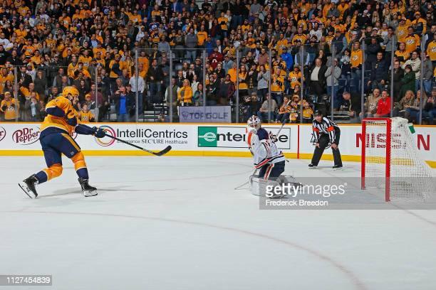 Brian Boyle of the Nashville Predators scores a goal against goalie Mikko Koskinen of the Edmonton Oilers to win a 32 Nashville shootout victory over...