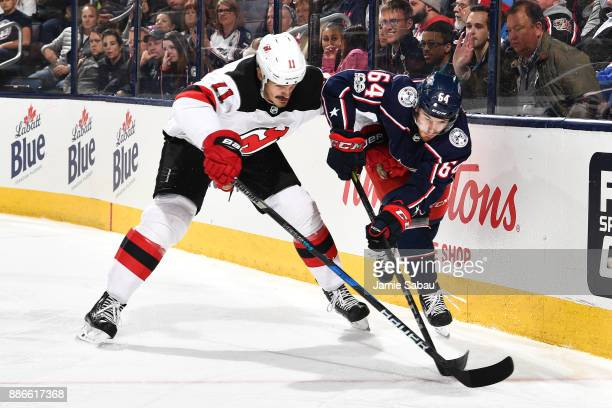Brian Boyle of the New Jersey Devils and Tyler Motte of the Columbus Blue Jackets battle for the puck during the third period of a game on December 5...