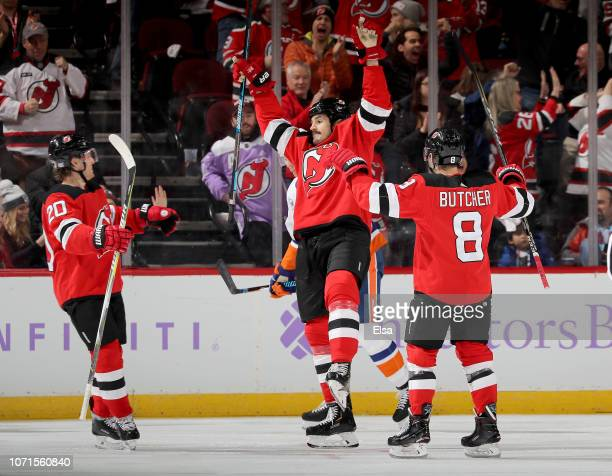 Brian Boyle of the New Jersey Devils celebrates his goal with teammates Blake Coleman and Will Butcher in the third period against the New York...