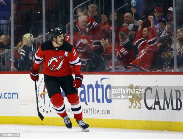 Brian Boyle of the New Jersey Devils celebrates his shootout game winning goal against the New York Rangers at the Prudential Center on December 21...