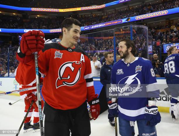 Brian Boyle of the New Jersey Devils chats with Nikita Kucherov of the Tampa Bay Lightning during the 2018 GEICO NHL AllStar Skills Competition at...