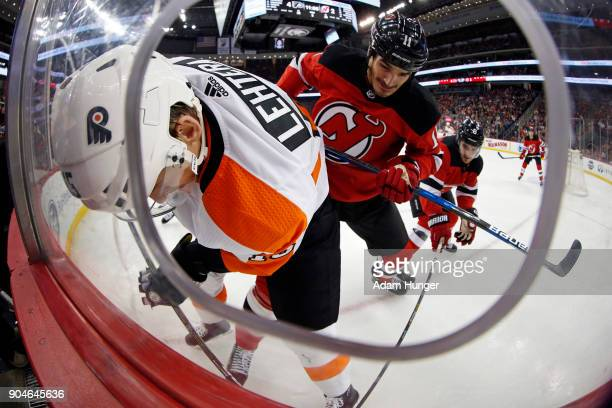 Brian Boyle of the New Jersey Devils checks Jori Lehtera of the Philadelphia Flyers during the third period at the Prudential Center on January 13...