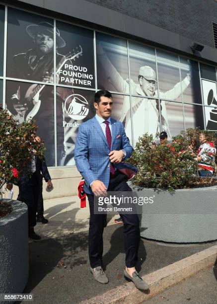 Brian Boyle of the New Jersey Devils heads for the red carpet prior to the game against the Colorado Avalanche at the Prudential Center on October 7...