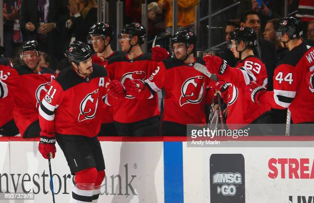 Brian Boyle of the New Jersey Devils is congratulated after scoring an empty net goal against the Dallas Stars during the game at Prudential Center...