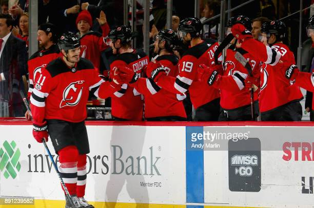 Brian Boyle of the New Jersey Devils is congratulated by his teammates after scoring a secondperiod goal against the Los Angeles Kings during the...