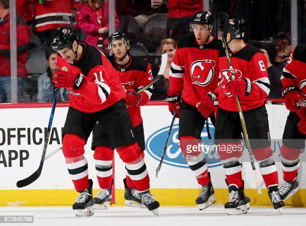 Brian Boyle of the New Jersey Devils is congratulated by teammates after he scored a goal in the first period against the Edmonton Oilers on November...