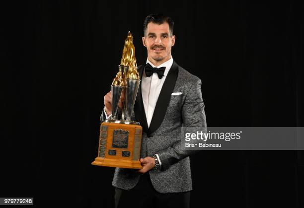 Brian Boyle of the New Jersey Devils poses for a portrait with the Bill Masterton Memorial Trophy at the 2018 NHL Awards at the Hard Rock Hotel...