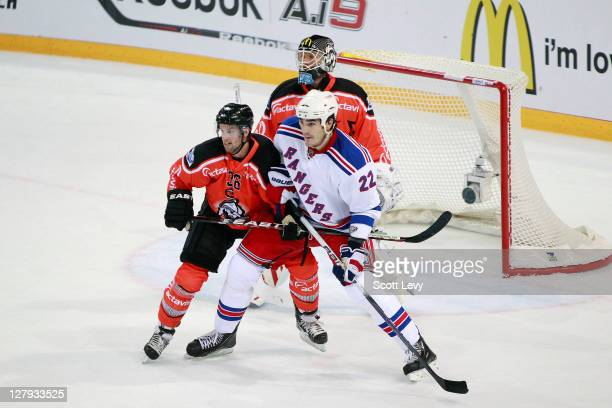 Brian Boyle of the New York Rangers battles for position in front of the net against Andreas Furrer of EV Zug at the Bossard Arena during the 2011...