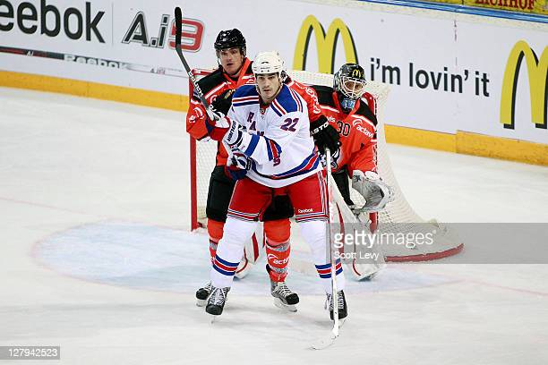 Brian Boyle of the New York Rangers battles for position in front of the net against Chiesa Alessandro of EV Zug at the Bossard Arena during the 2011...