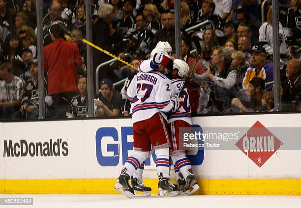 Brian Boyle of the New York Rangers celebrates with teammates Ryan McDonagh and Martin St Louis after Boyle scores a second period goal past...