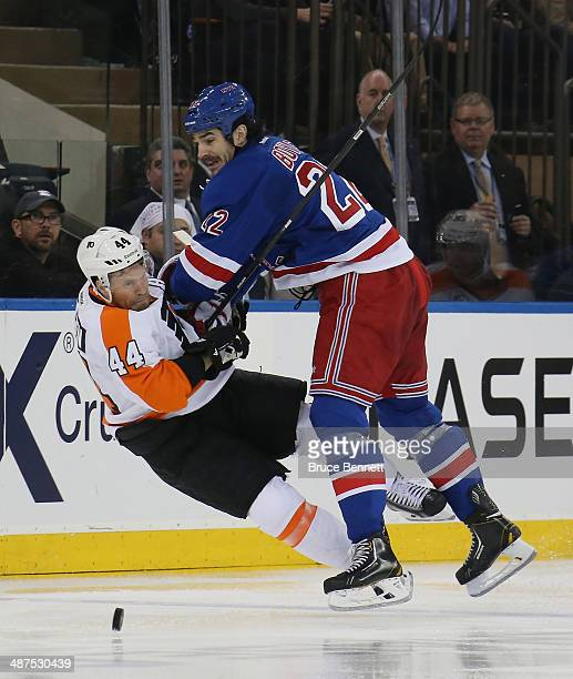 Brian Boyle of the New York Rangers hits Kimmo Timonen of the Philadelphia Flyers in Game Seven of the First Round of the 2014 NHL Stanley Cup...